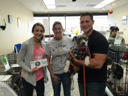 Fitbull Clothing owners Kelly and Cole Watkins make a donation to K-9 Angels Rescue.